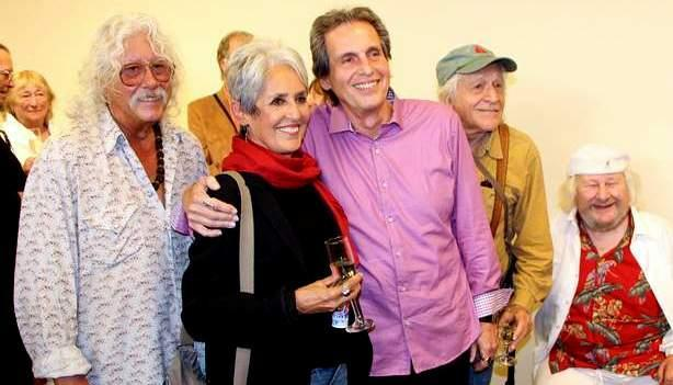 Paul Liberatore, center, is joined by musicians (from left) Arlo Guthrie, Joan Baez and Ramlin' Jack Elliott, as well as Wavy Gravy, right, during a ceremony to honor Liberatore as 2014 Marin Cultural Icon on Sunday, April 13, 2014. (Courtesy of County of Marin)