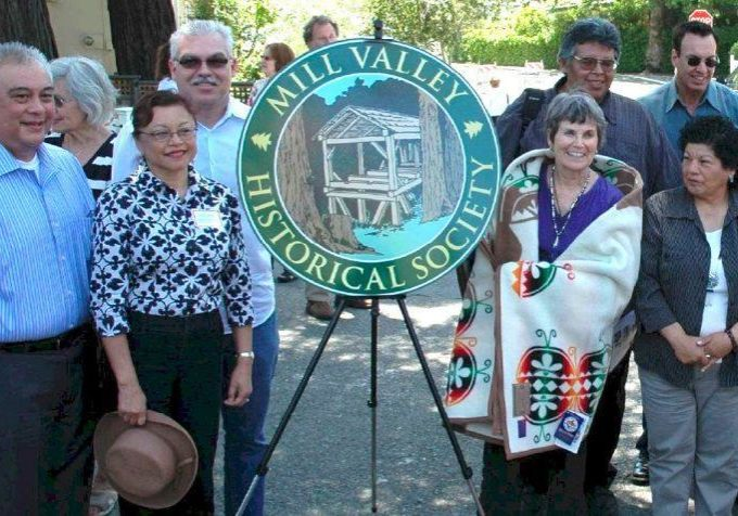 "The dedication in May, 2009, of a bronze plaque commemorating Chief Marin's birthplace in Mill Valley. Betty Goerke, vice president of the Mill Valley Historical Society, receives a blanket from the Coast Miwok tribal council recognizing her new status as an honorary tribal member. Goerke is the author of ""Chief Marin: Leader, Rebel and Legend"" and a resident of Mill Valley since 1962."